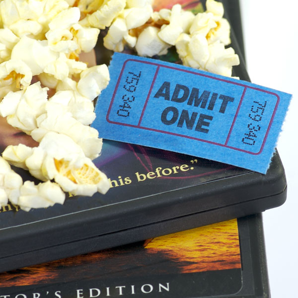 d v d boxes with popcorn and movie ticket