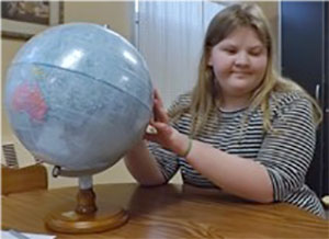 blond haired girl with globe