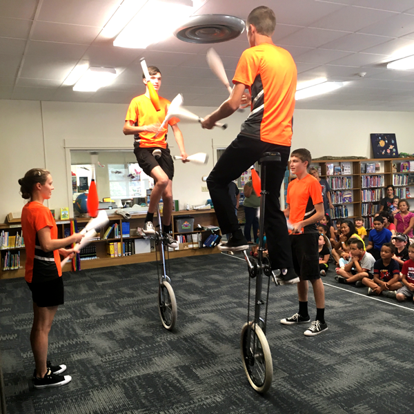jugglers on unicycles
