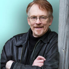 man wearing glasses and black leather jacket